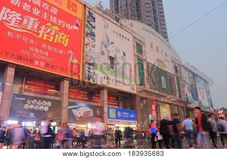 GUANGZHOU CHINA - NOVEMBER 12, 2016: Unidentified people visit Liwan Plaza Shangxiajiu pedestrian street. Shangxiajiu is the first business street in Guangzhou opened in 1999