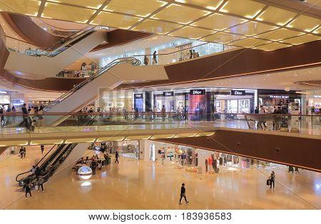GUANGZHOU CHINA - NOVEMBER 13, 2016: Unidentified people visit Taikoo Hui shopping mall. Taikoo Hui consists of a shopping mall, 2 office towers and Guangzhous first 5 star Mandarin Oriental Hotel