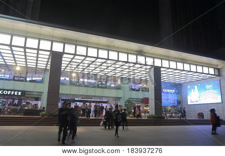 GUANGZHOU CHINA - NOVEMBER 13, 2016: Unidentified people visit Teem Plaza. Teem Plaza is a twin tower complex with Sheraton Hotel and shopping mall built in 2008.