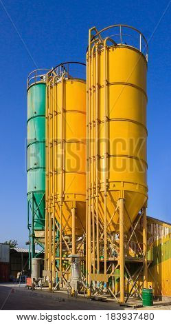 Bright round metal multi-colored towers on chemical plant