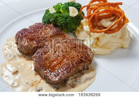 Fried Steaks With Potatoes, Fried Onion And Cream Sauce.