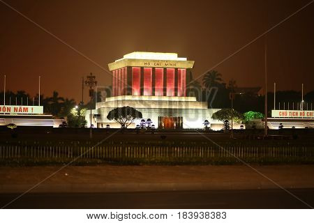 Night photo of the Ho Chi Minh Mausoleum in Hanoi, Vietnam.