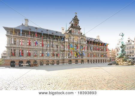 City hall with flags of many nationalities in center of Antwerp, Belgium