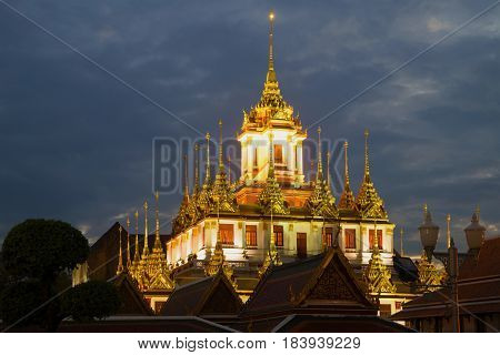 A view of the top of Chedi Loha Prasat (Metal Palace) of the Buddhist temple of Wat Ratchanadda in the evening twilight. Bangkok Thailand