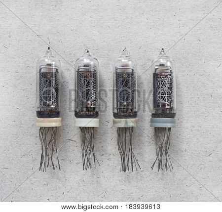 Top view of vintage USSR nixie tubes on craft paper background