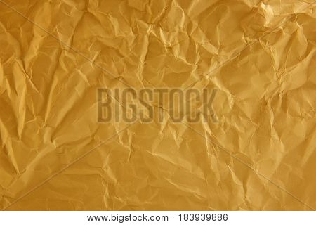 The wrinkled paper yellow color texture background