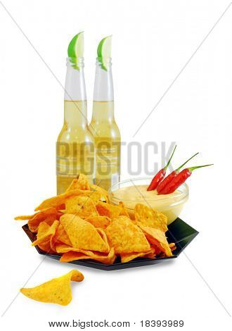 Nacho cheese tortilla chips with chili cheese dip and red chili peppers, isolated on white with fresh beers on the background