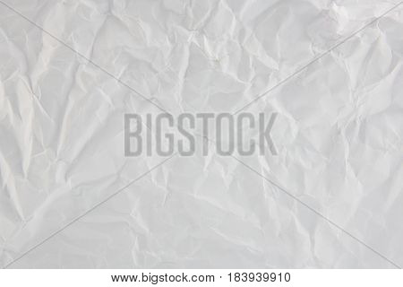 The wrinkled paper white color texture background