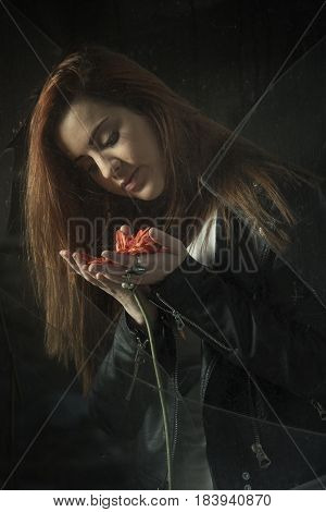 Beautiful Girl Behind Old Dirty Glass possing