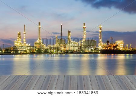 Opening wooden floor Night oil refinery river side light night view industrial background