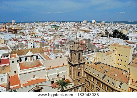 CADIZ, SPAIN - SEPTEMBER 8, 2008 - View of the Santiago church bell tower and city rooftops with the sea to the rear seen from the top of the Cathedral Cadiz Cadiz Province Andalusia Spain Western Europe. September 8, 2008.