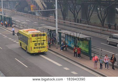 GUANGZHOU CHINA - NOVEMBER 13, 2016: Unidentified people commute by bus.