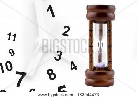 Time Running Out: Sand Falling Inside Hourglass, With Analog Clock In Background, Time Gradually Run