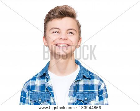 Close up emotional portrait of caucasian smiling teen boy. Head shot of handsome guy. Funny cut laughing teenager, isolated on white background. Child looking away.