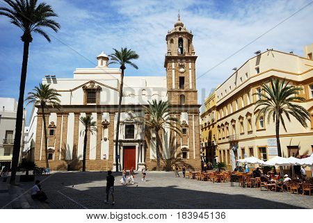CADIZ, SPAIN - SEPTMEBER 8, 2008 - Santiago church in Cathedral Square with pavement cafes to the right hand side Cadiz Cadiz Province Andalusia Spain Western Europe, September 8, 2008.