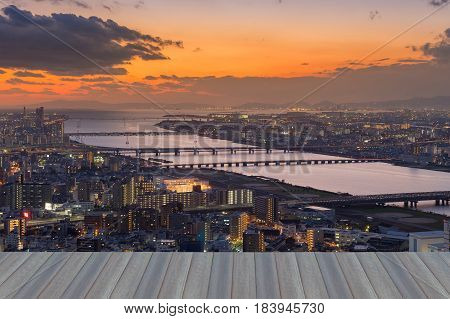 Opening wooden floor Umeda urban downtown aerial view with sunset skyline background Japan