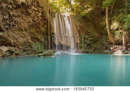 Beautiful natural deep tropical forest waterfall natural landscape background