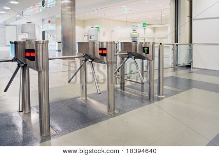 Turnstile entrance and exit gates at big event or trade center poster