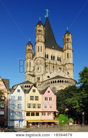Colored houses and St. Martin's church in Cologne, Germany