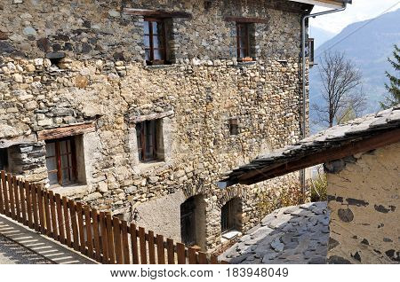 stone facade of a typical alpine moutain