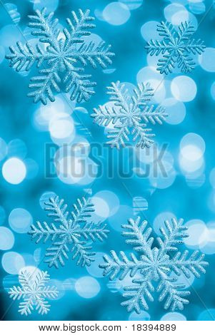Ice stars and Christmas lights in blue tone