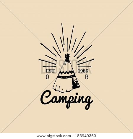 Vector tribal camp logo. Tourism sign with hand drawn indian wigwam. Retro hipster emblem, badge, label of outdoor adventures.