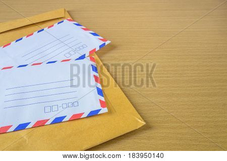 The air mail letter on wood background.