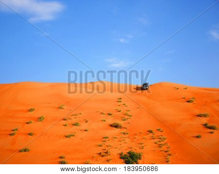 Orange Wahiba desert dune bashing with 4 wheels truck