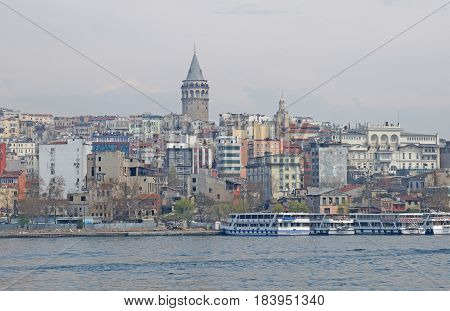 Galata Tower. View of the Galata Tower. Beyoglu. Types of Istanbul. View of Istanbul from the water, from the Bosphorus. City landscape. Spring in Istanbul. Istanbul in cloudy weather.