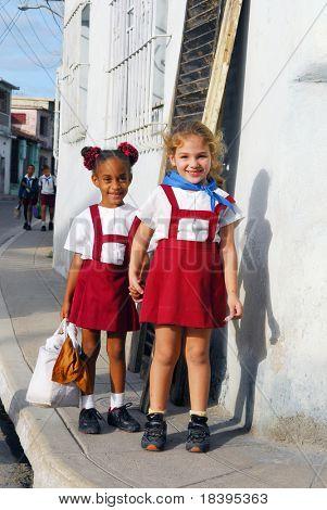 CAMAGUEY,CUBA- CIRCA NOVEMBER 2008: Unidentified schoolgirls in red school uniform in the city of Camaguey, Cuba circa November 2008. The town was designated a UNESCO World Heritage Site in July 2008.