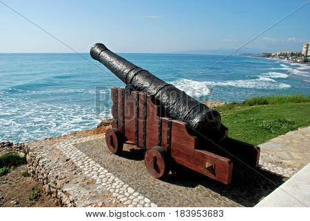 Cannon on the edge of sea with views along the beach and coastline Torrox Costa Malaga Province Andalusia Spain Western Europe.