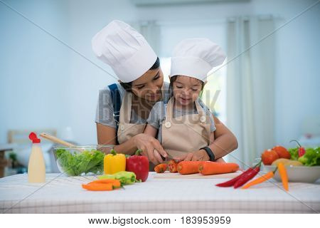 Mother and daughter cooking togather for making salad and prepare vegetable in kitchen room