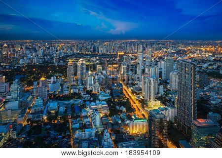 Rooftop viewpoint from Mahanakorn building see Bangkok city lumpini park Silom and cityscape on blue sky time Bangkok Thailand. Photo include space at sky for put your text