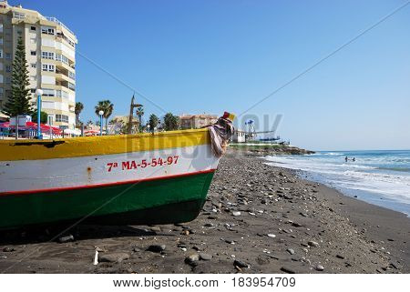 TORROX COSTA, SPAIN - OCTOBER 27, 2008 - Traditional wooden fishing boat on the beach Torrox Costa Malaga Province Andalusia Spain Western Europe, October 27, 2008.