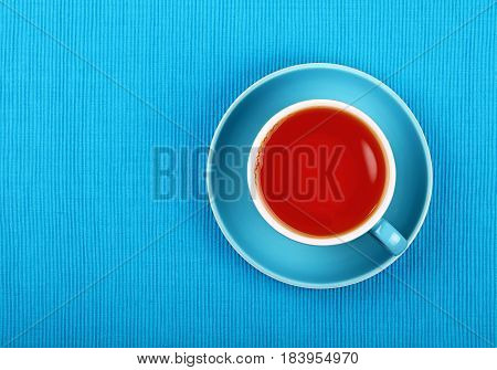 Full Black Tea In Blue Cup Close Up Top View