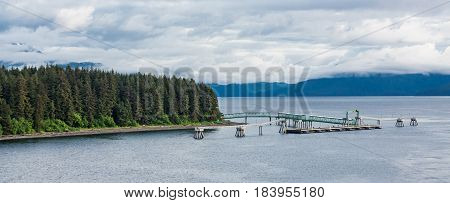 Dock in Icy Straight Alaska Under Cloudy Skies