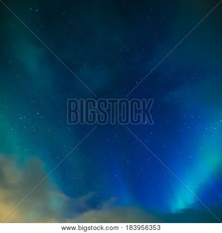 Aurora Borealis Known as Norther Lights Playing with Vivid Colors Over Lofoten Islands in Norway. Square Image