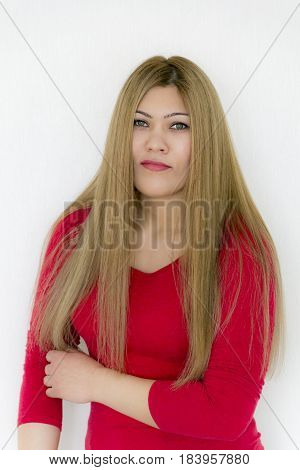 Seriously attractive young girl with long brown healthy straight hair in red