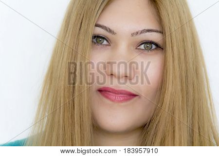 Attractive young girl with straight hair and green eyes