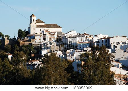 View of the white village with the church at the top Alozaina Malaga Province Andalusia Spain Western Europe.