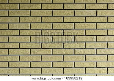 Background. Brick wall of yellow brown. ement