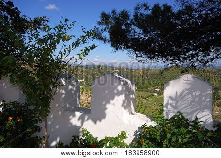 View of the countryside seen through the town battlements Alozaina Malaga Province Andalusia Spain Western Europe.