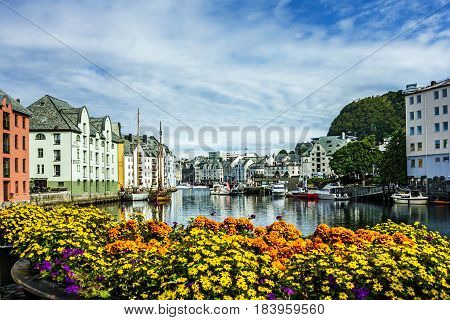 Alesund, Norway - April 3, 2017: Seafront of town and sea port Alesund, Norway.