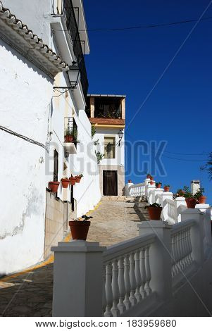Townhouses along a steep village street Alozaina Malaga Province Andalusia Spain Western Europe.