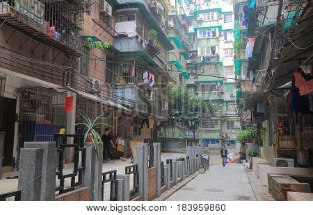 GUANGZHOU CHINA - NOVEMBER 13, 2016: Unidentified people walk on a small alley in residential area of Guangzhou.