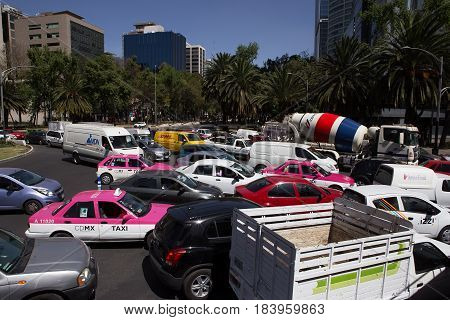 MEXICO CITY, MEXICO - FEB 09, 2017: Vehicles stand at a standstill on a Paseo Reforma intersection.