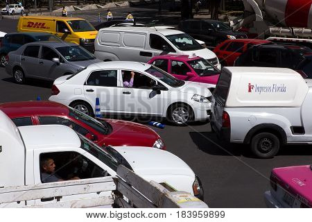 MEXICO CITY, MEXICO - FEB 09, 2017: Traffic stands at a standstill on a Paseo Reforma intersection.