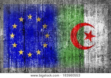 EU and Algeria flag on concrete wall