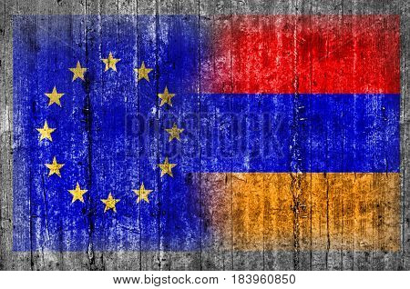 EU and Armenia flag on concrete wall
