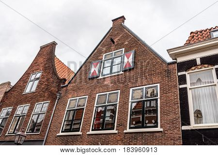 Haarlem Netherlands - August 3 2016: Low angle view of traditional brick houses in Haarlem